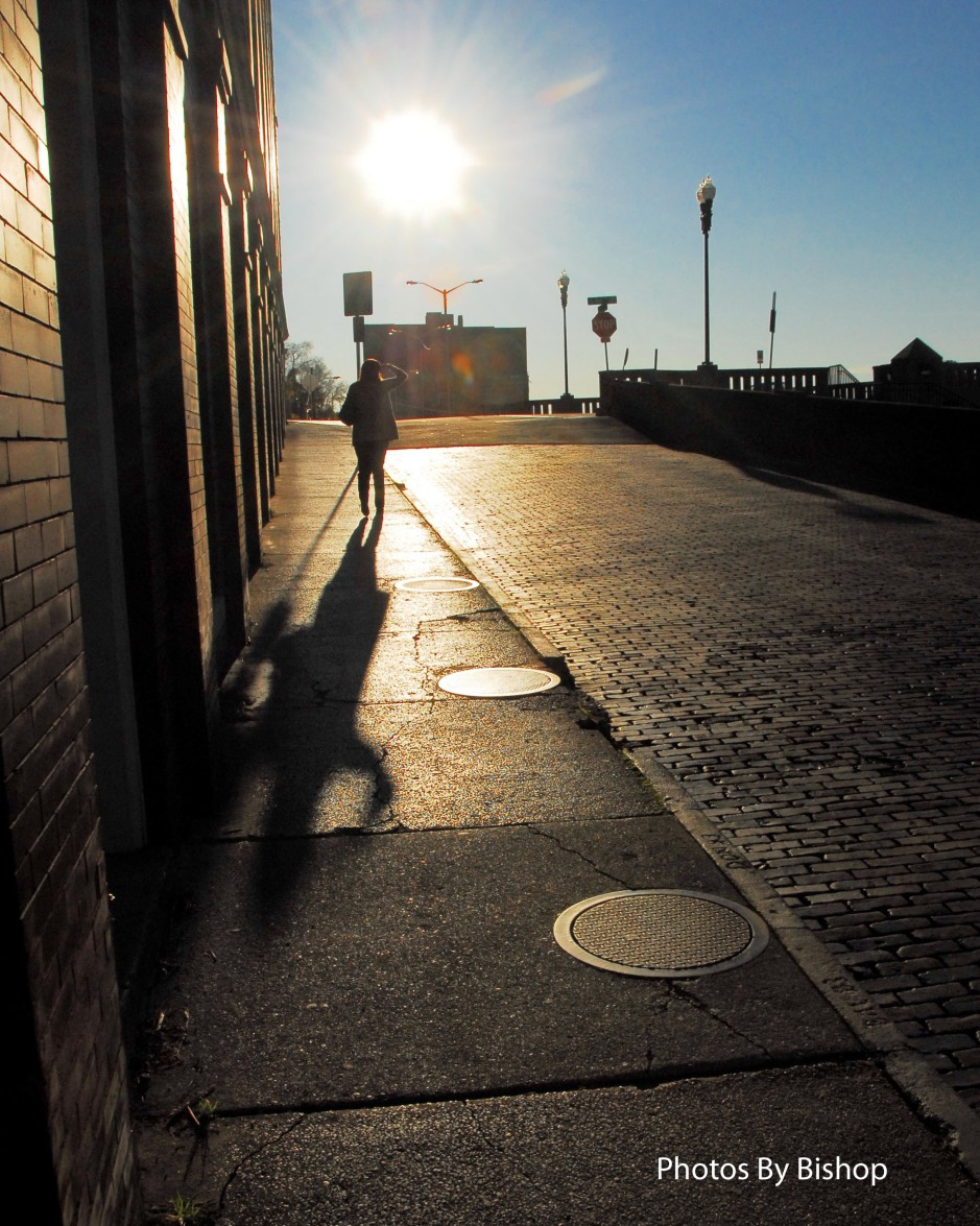 Old Town Knoxville, Tennessee, backlit woman walking up the street.